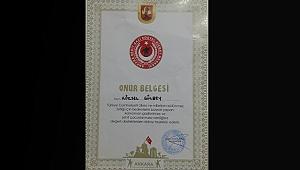 ASİMDER Başkanı Gülbey'e Ankara Şehit Gazi Ailerince Onur Belgesi Verildi